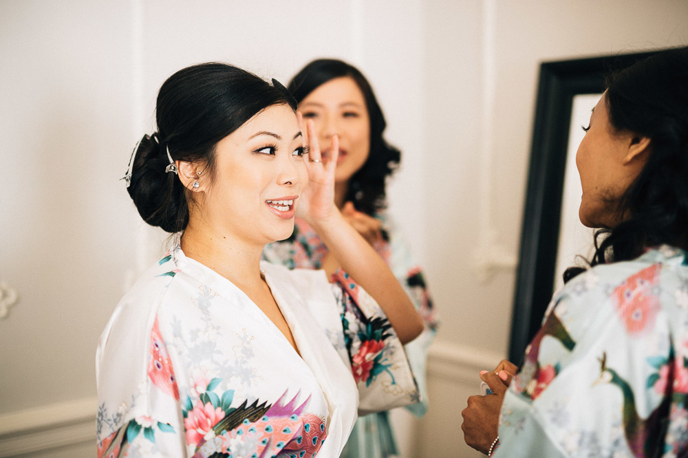 bride candid with bridesmaids at the vancouver club wedding photography