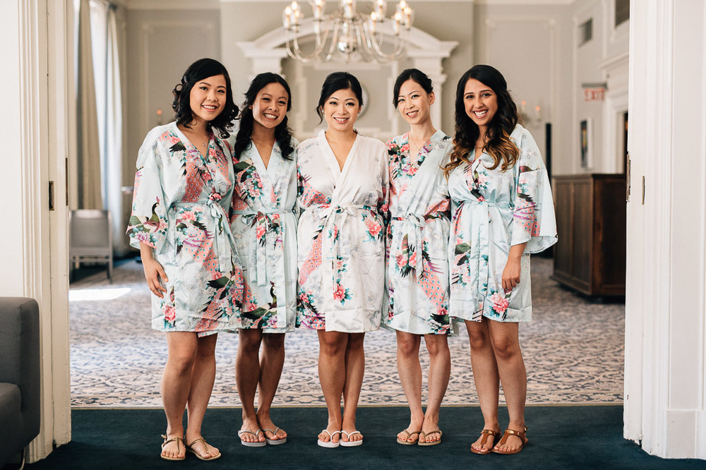 bride and bridesmaids portrait at the vancouver club in coal harbour