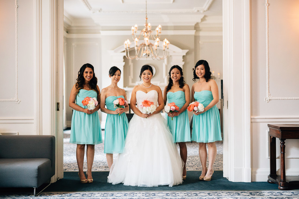 bride and bridesmaids group portrait at the vancouver club for wedding
