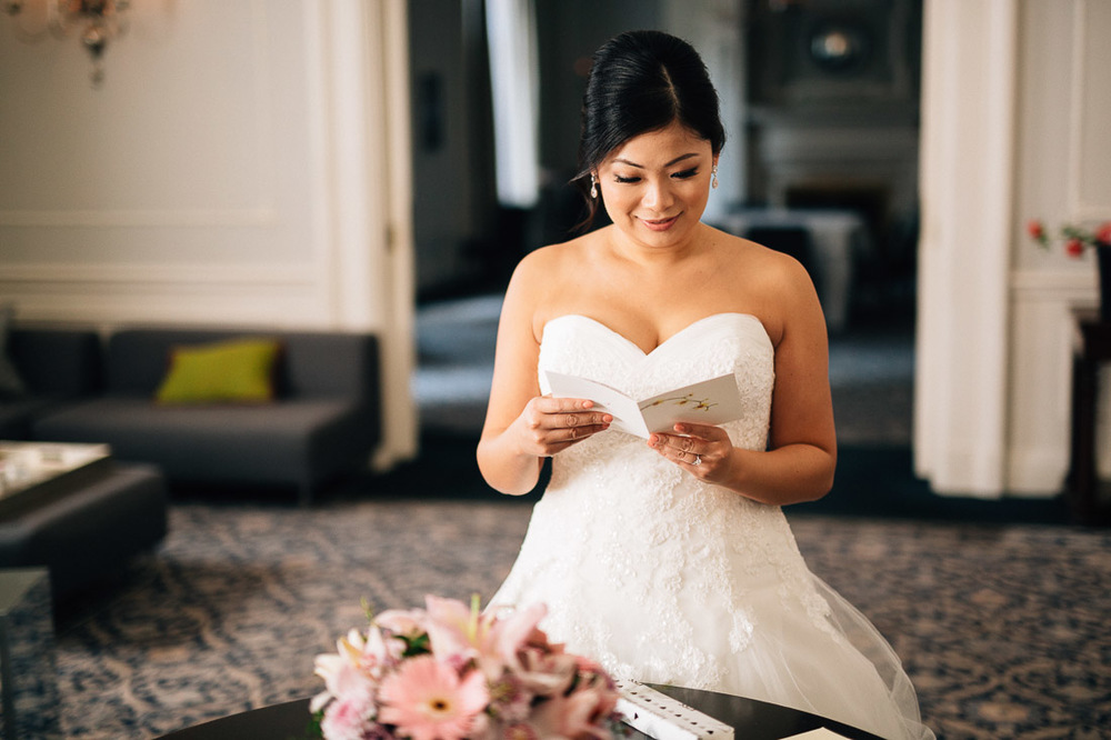 bride opening gift from groom at the vancouver club wedding