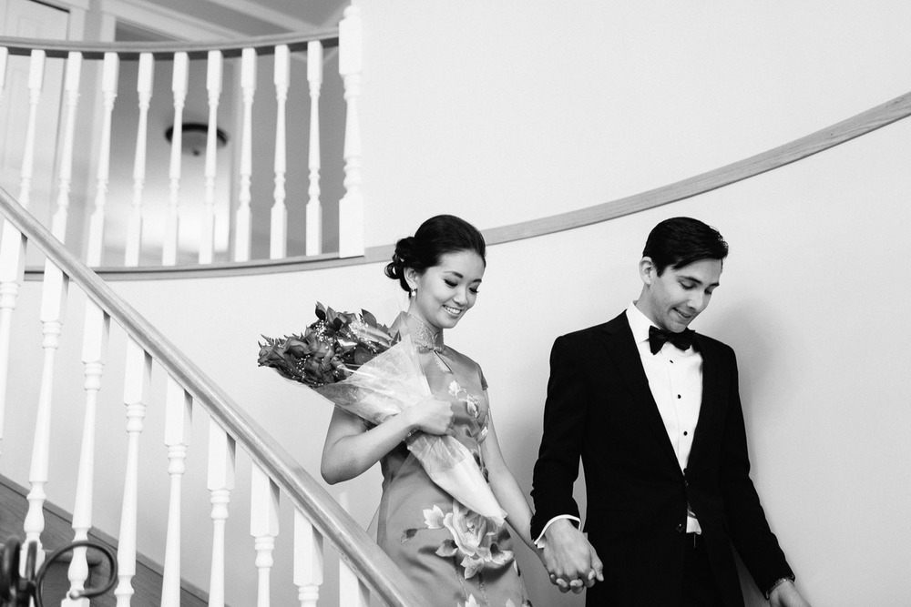 bride and groom walking downstairs vancouver wedding photography