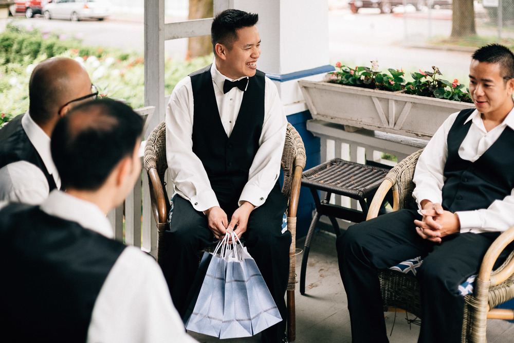 groom giving gifts to groomsmen vancouver wedding photography