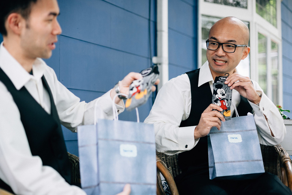 groomsman receiving disney sock gift from groom vancouver wedding photography