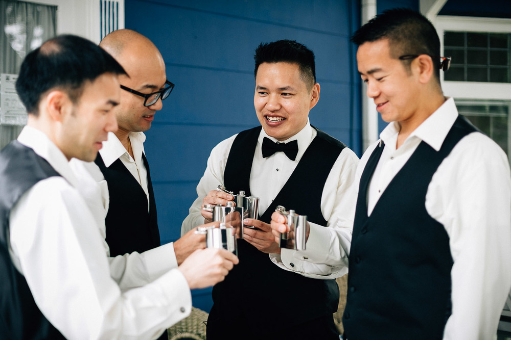 groomsmen celebrating gifts with groom