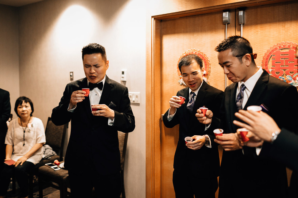 asian door games vancouver wedding photography with groom and groomsmen