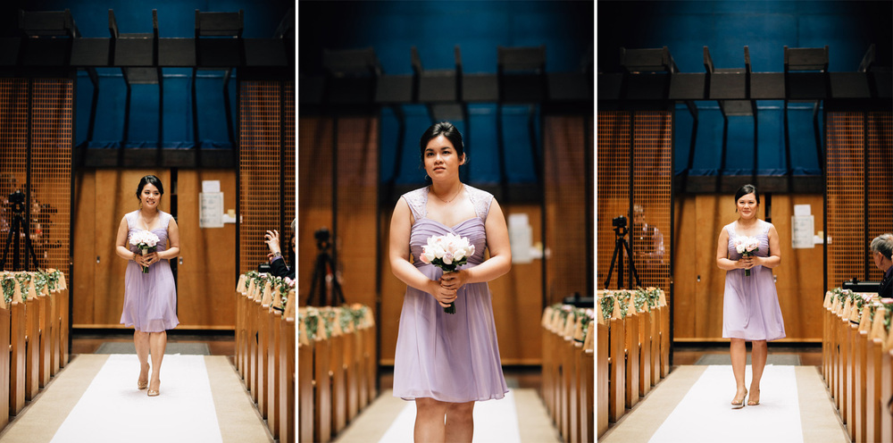 bridesmaids walking down aisle at redeemer lutheran church
