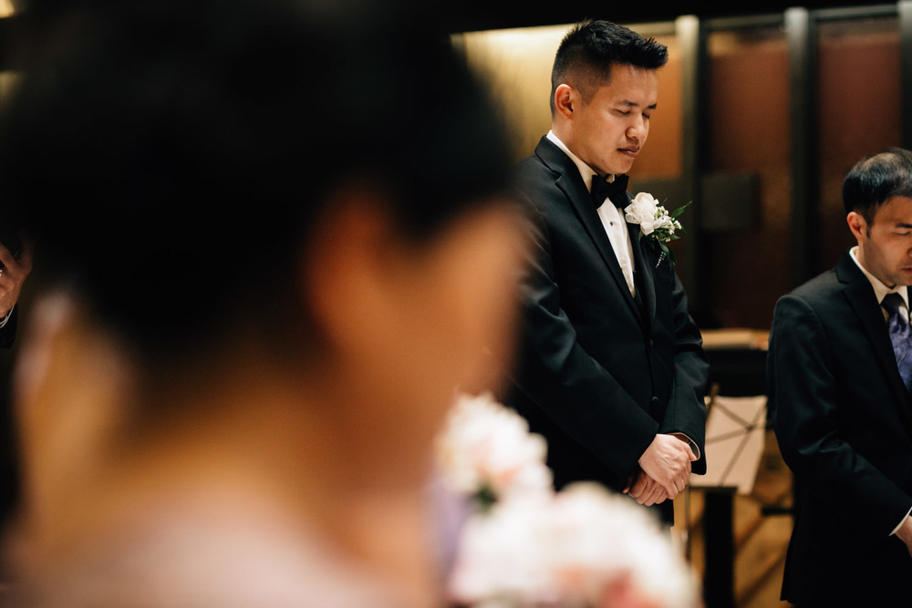 groom praying at redeemer lutheran church vancouver wedding photographer