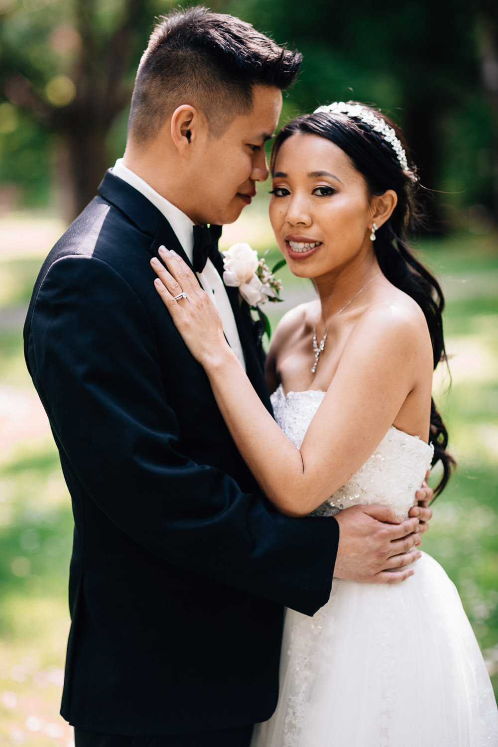 asian wedding couple portrait in stanley park rose garden vancouver