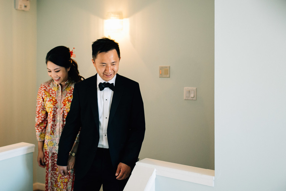 chinese bride and groom walking downstairs vancouver wedding photographer