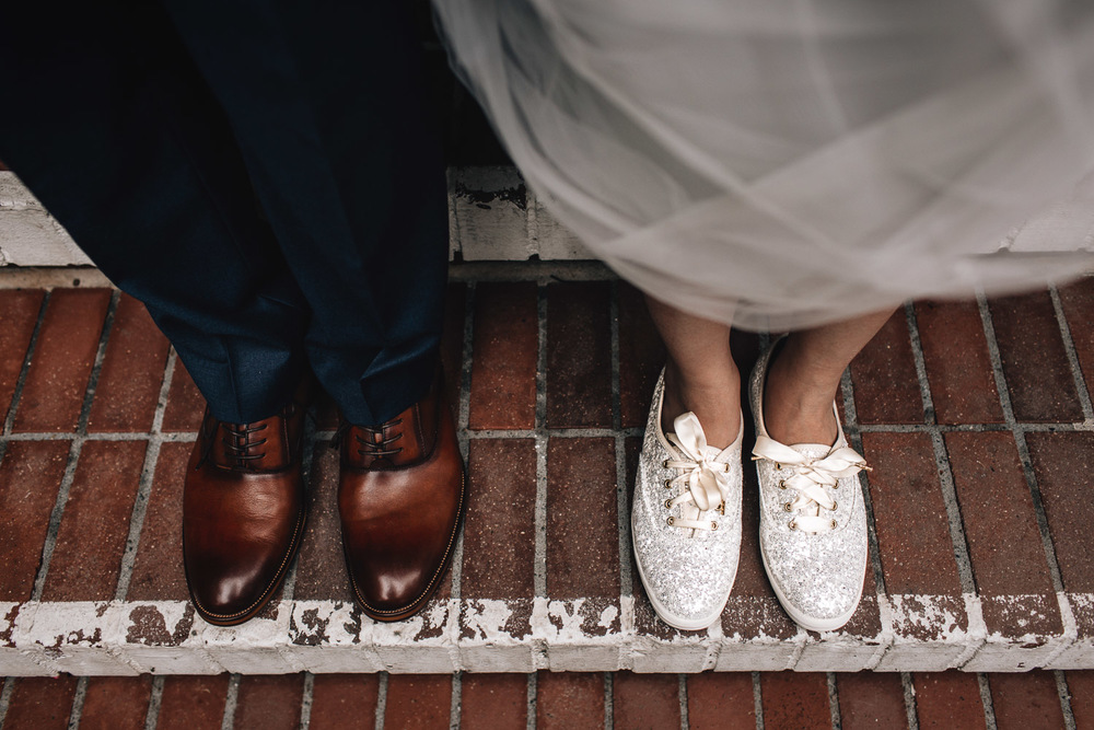 bride and groom shoes at brockhouse restaurant vancouver wedding photography