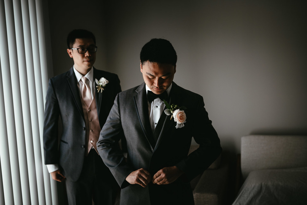 groom getting ready in vancouver bc for wedding photography
