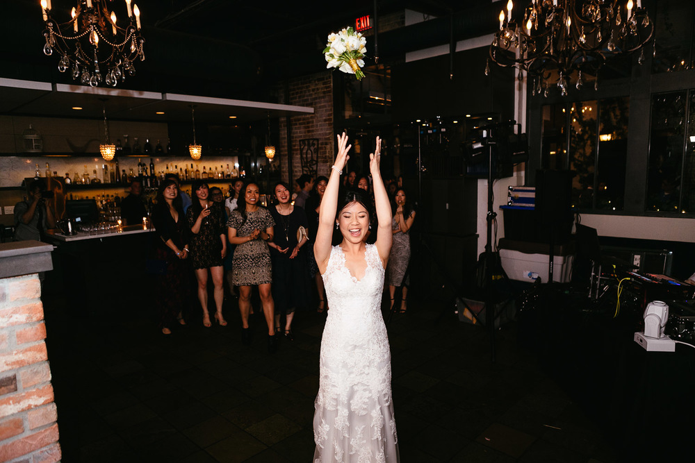 bouquet toss at brix and mortar vancouver wedding reception