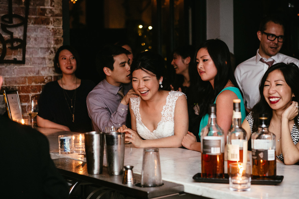 bride at bar in brix and mortar vancouver wedding photography