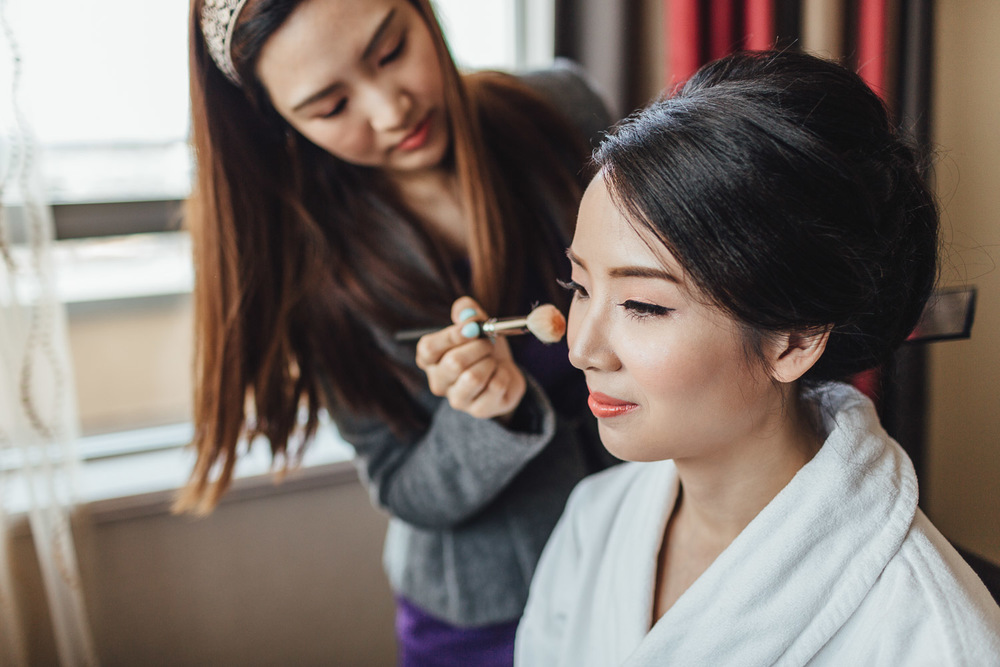 bride getting ready hair & makeup in river rock hotel in richmond bc