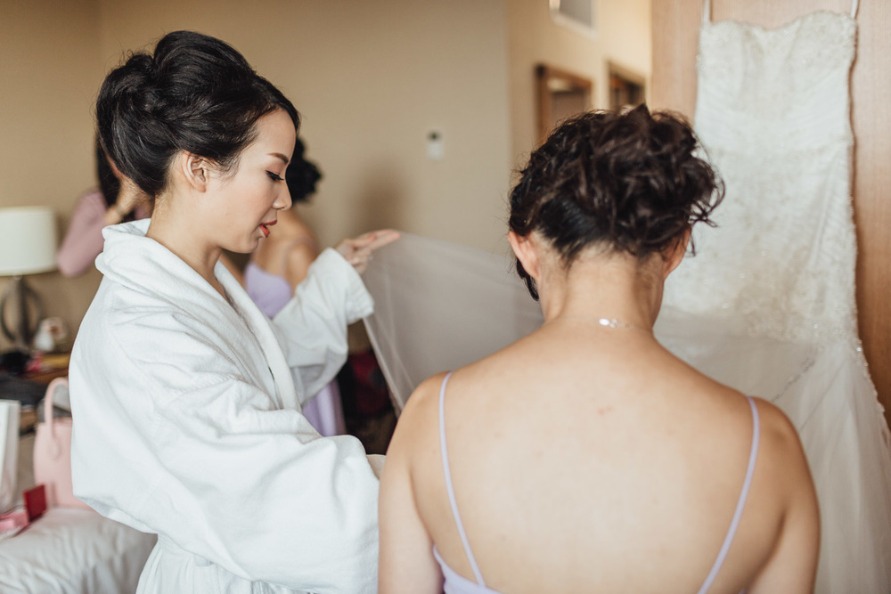 bride getting ready at river rock casino hotel in richmond bc