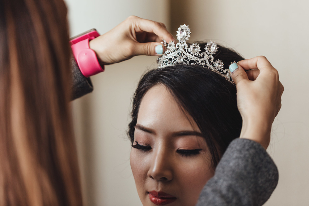 putting on tiara for bride wedding in richmond bc