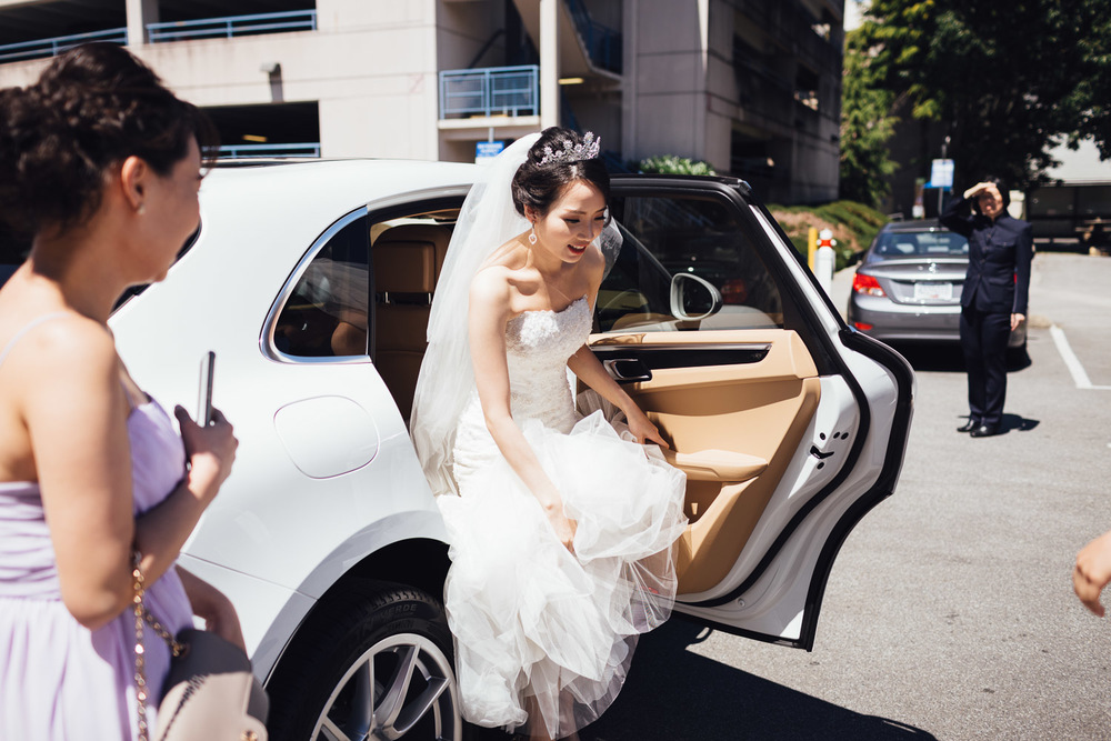 bride getting out of Porsche in richmond bc at minoru chapel for wedding