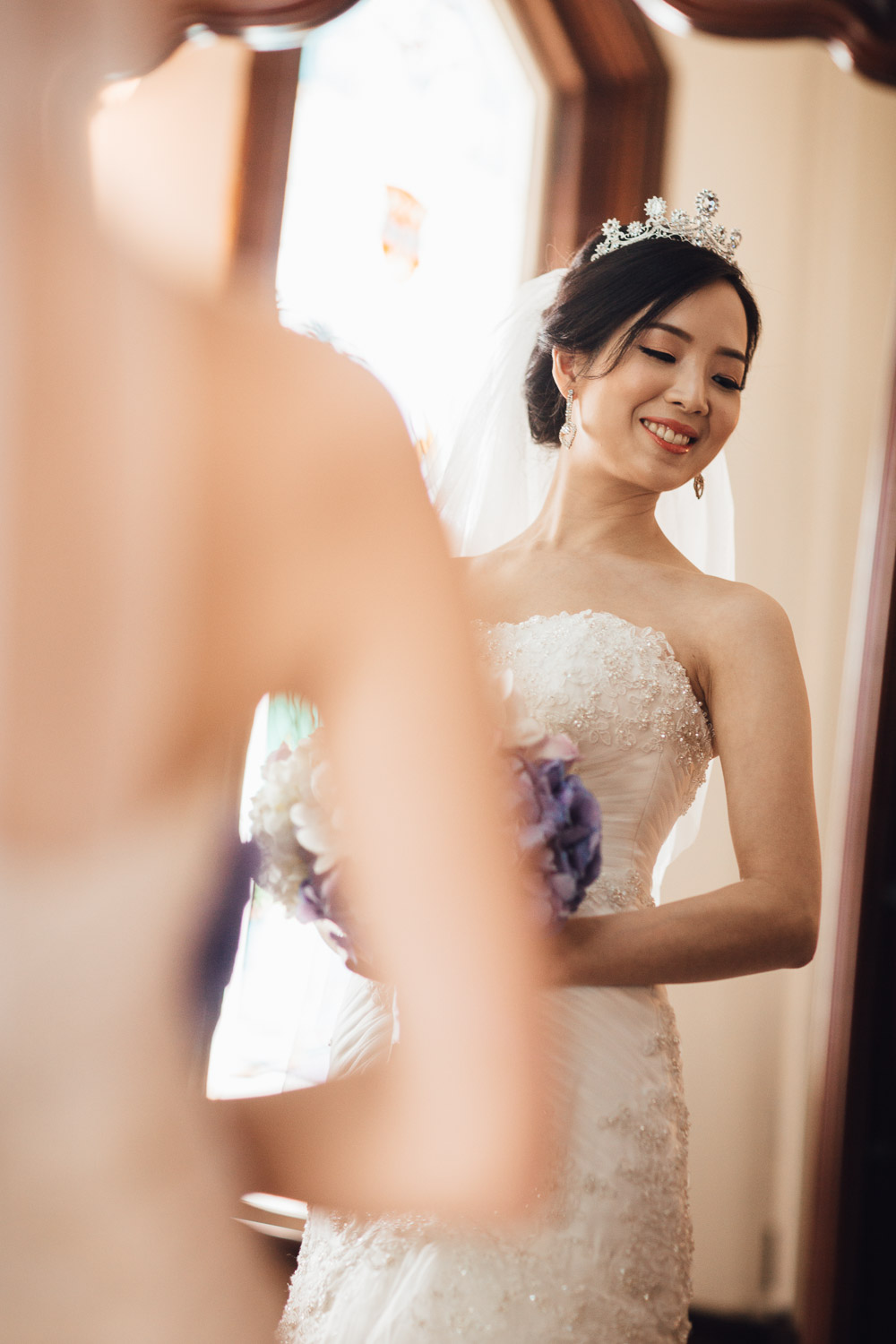 bride before ceremony mirror reflection in richmond bc at minoru chapel for wedding