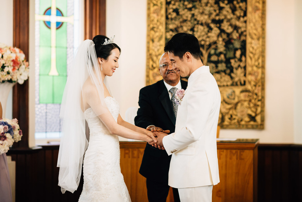 exchanging rings during wedding ceremony at minoru chapel in richmond bc