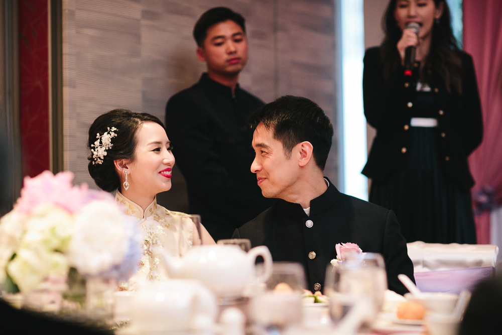 Bride and groom candid in reception of Kirin Restaurant wedding