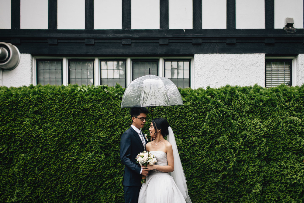 vancouver wedding in rain with umbrella at brockhouse restaurant