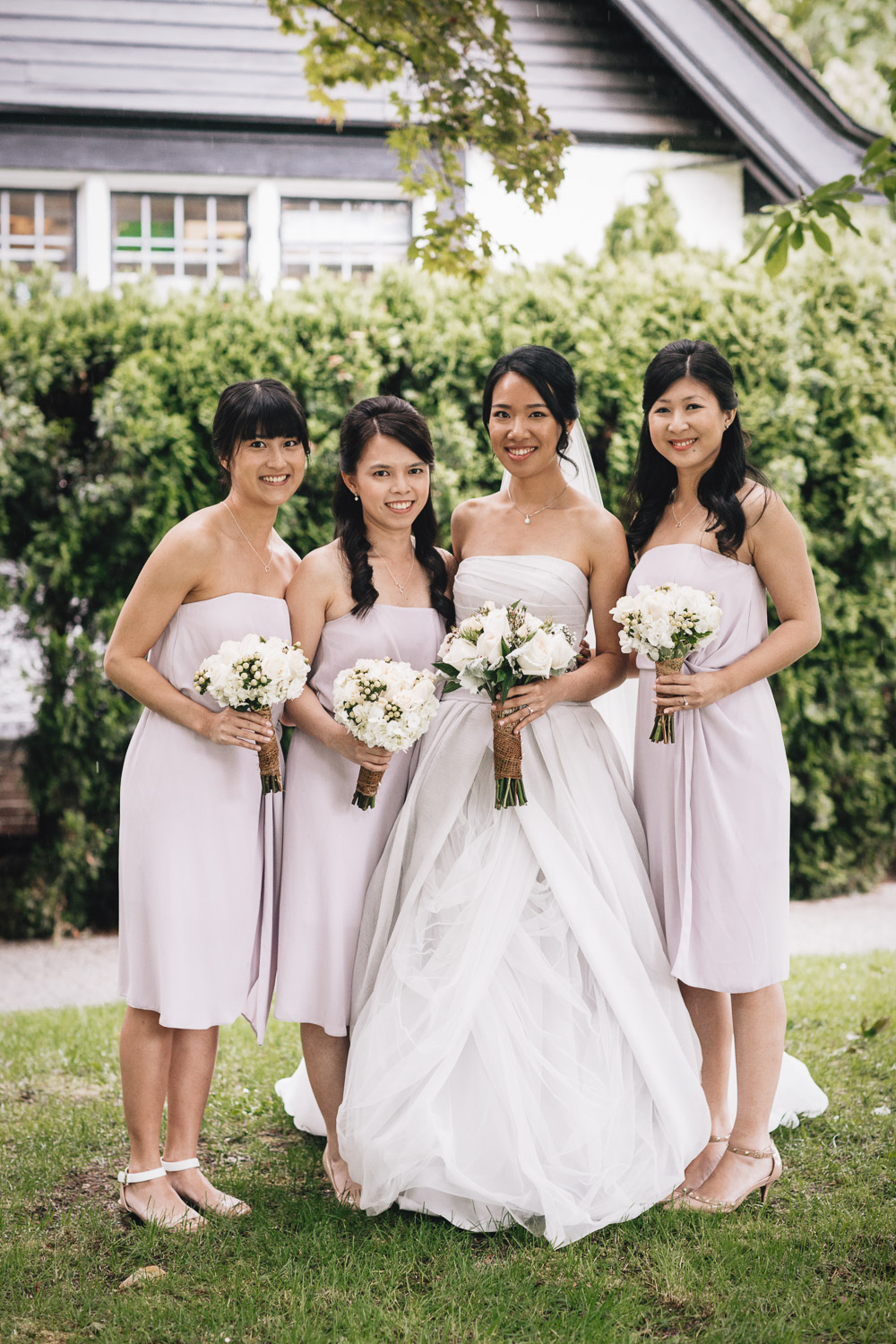 bride and bridesmaids portrait at brockhouse restaurant wedding in vancouver bc