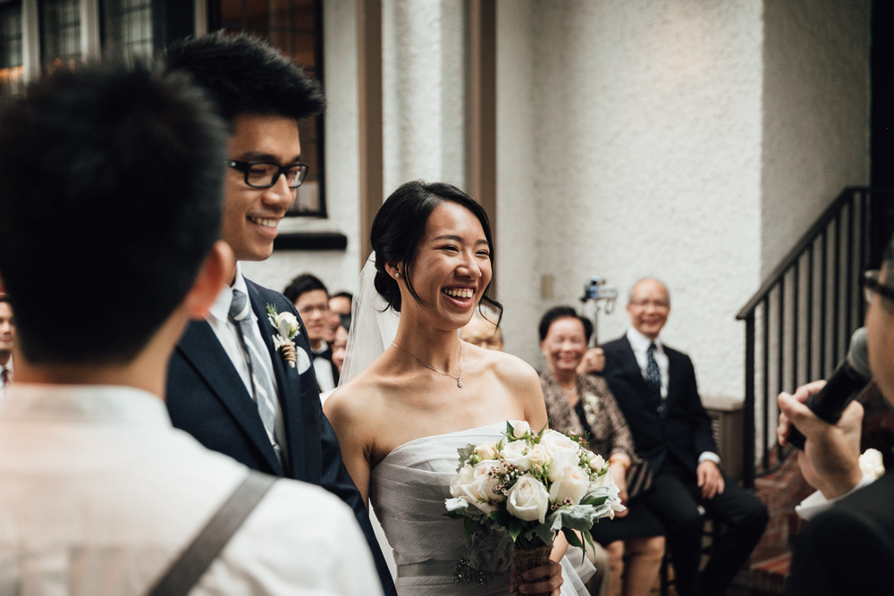 Bride laughing at brockhouse restaurant in vancouver wedding bc