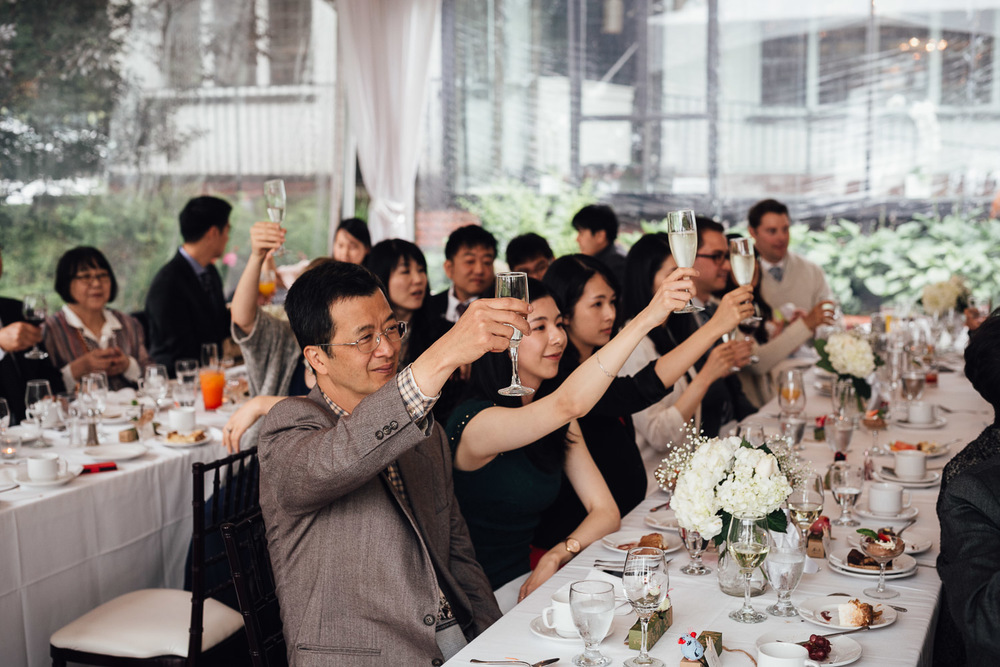 cheers toasting at brockhouse restaurant wedding lunch reception in vancouver bc