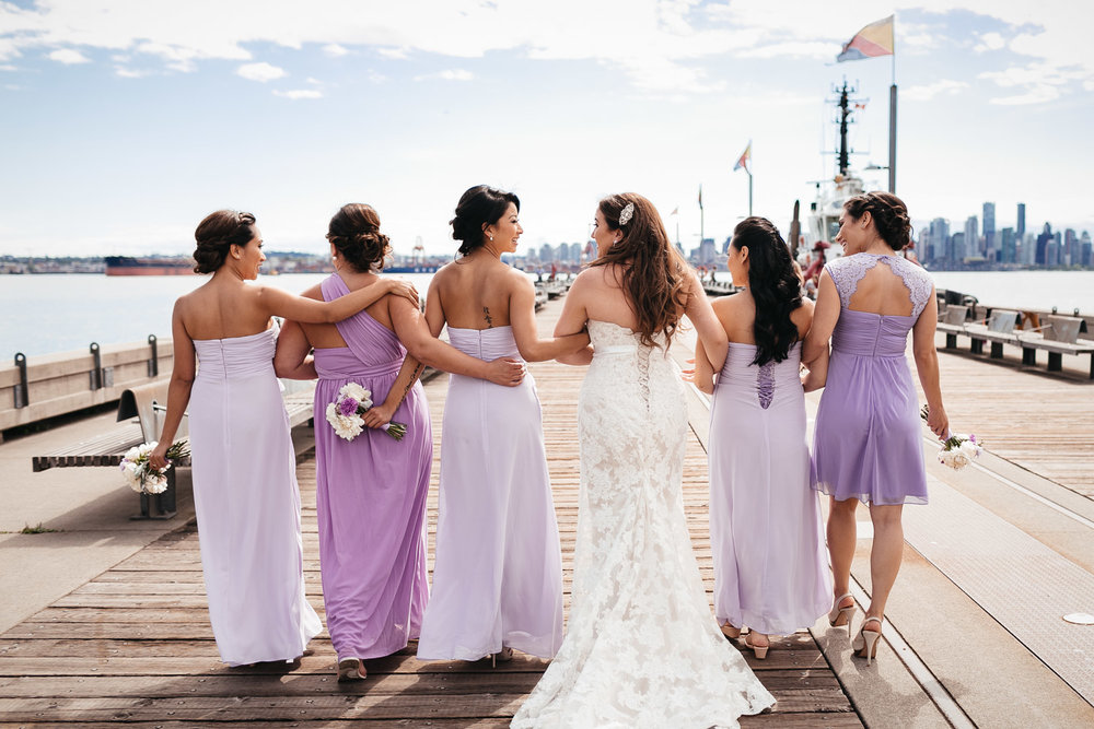 bridesmaids in north vancouver wedding photography at burrard dry dock pier