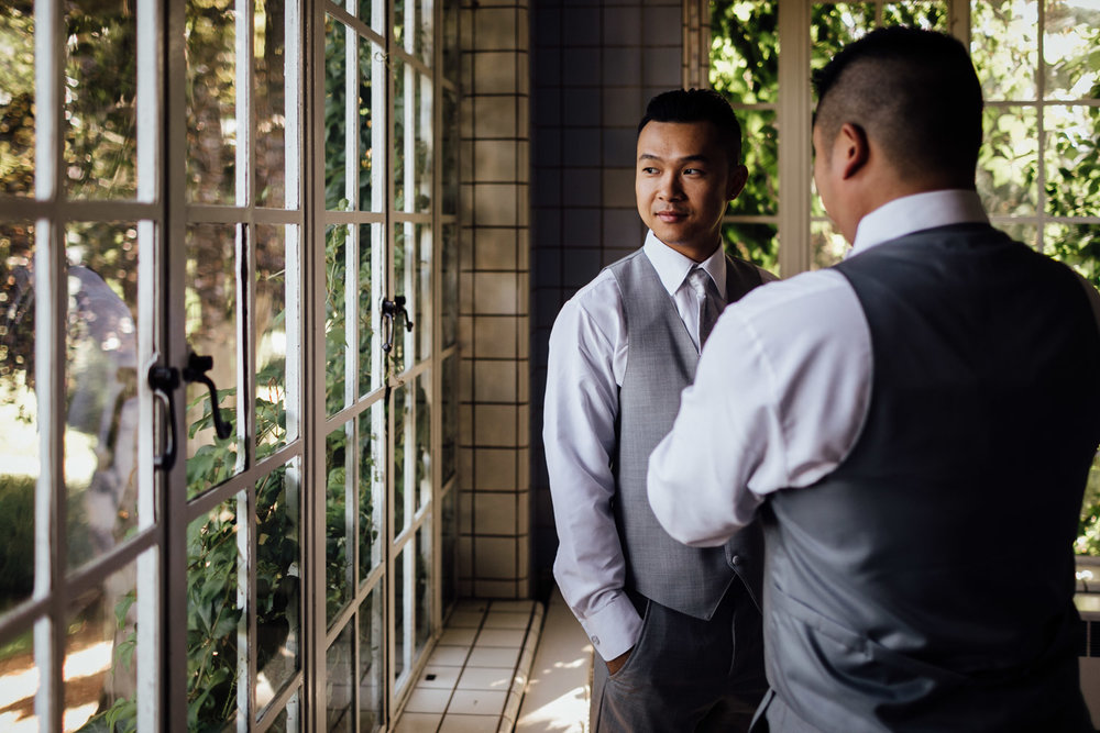 groom getting ready at hycroft in vancouver bc for wedding photography