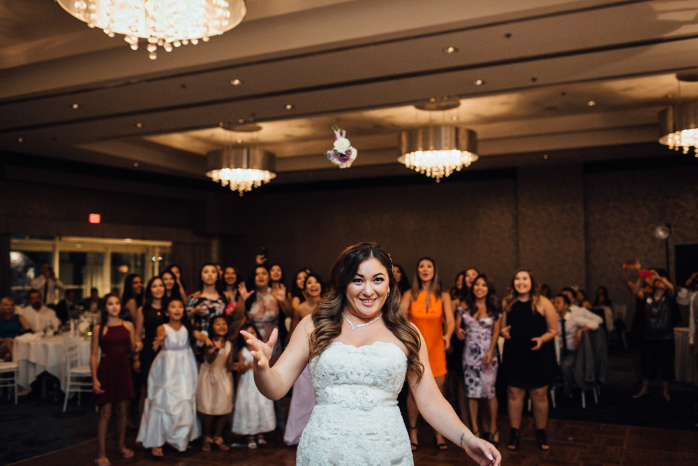 bouquet toss wedding reception photography in north vancouver pinnacle at the pier