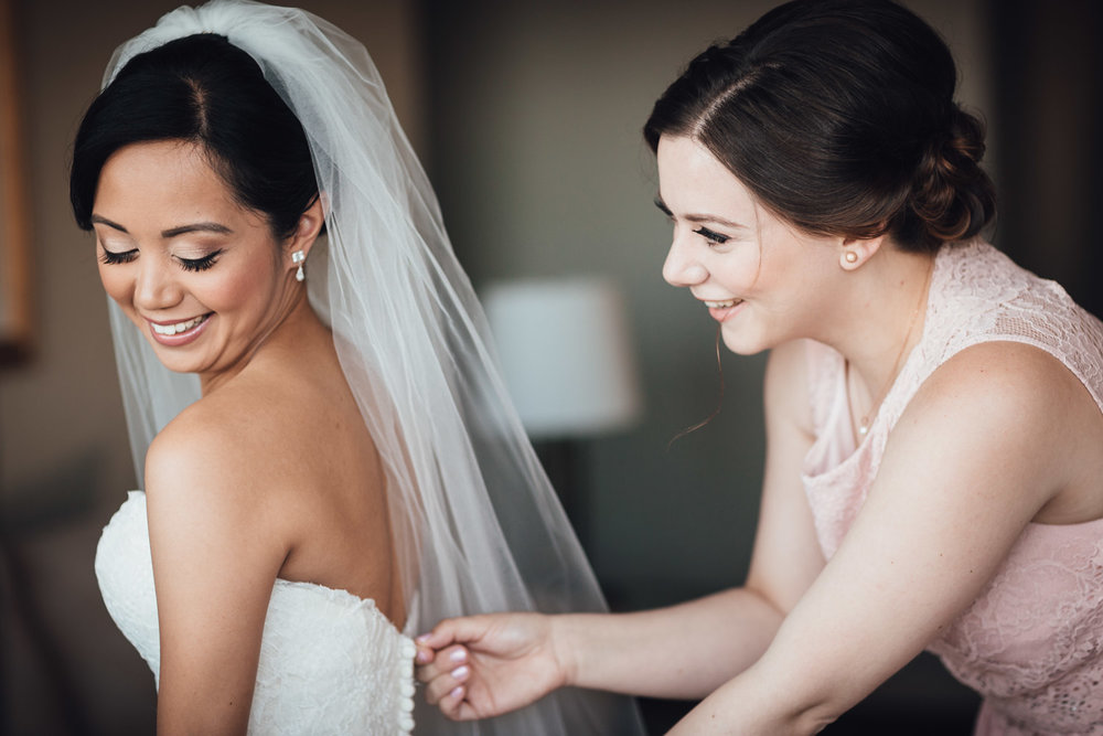 zipping up bridal dress wedding in vancouver at holiday inn