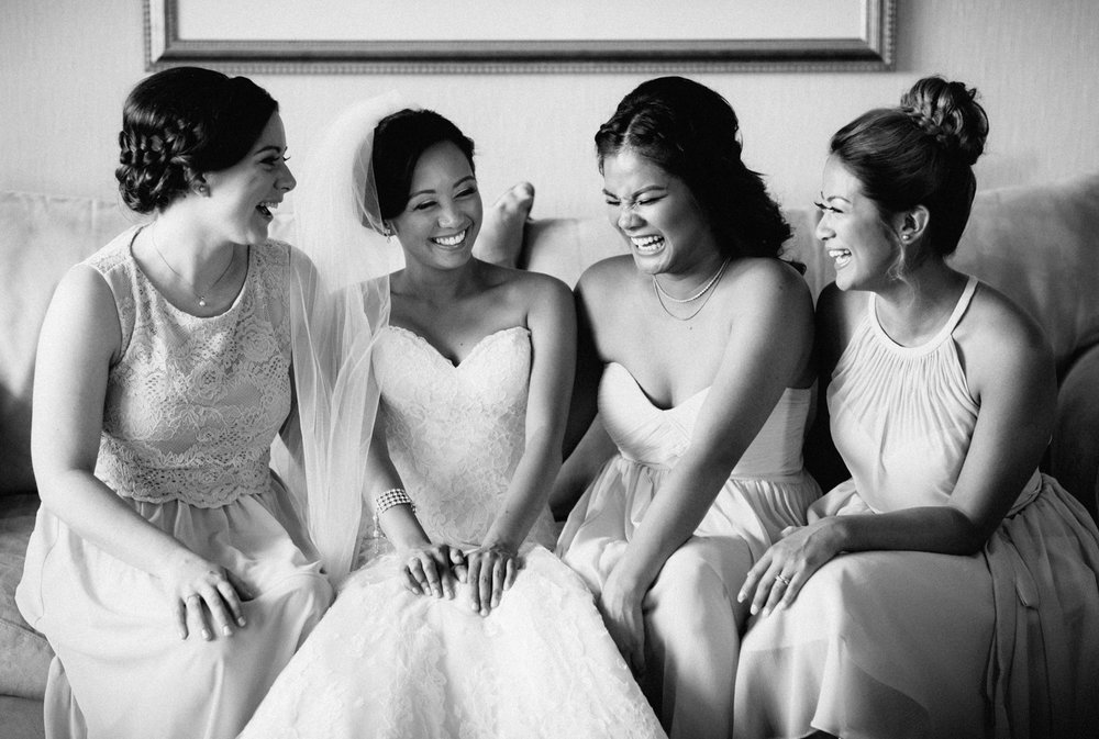 bride and bridesmaids candid laughing wedding vancouver bc