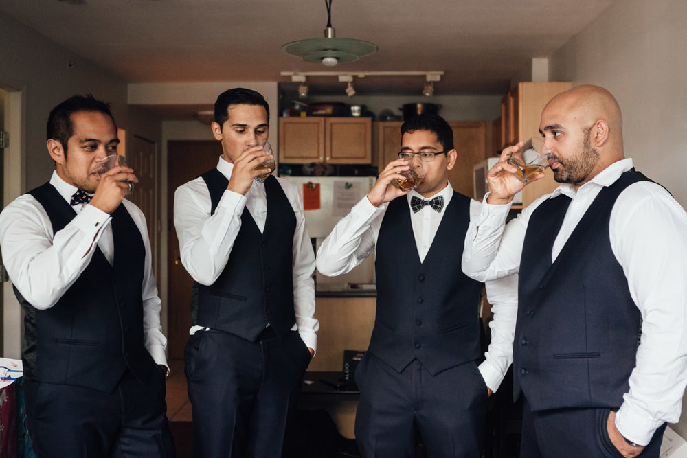 whiskey cheers with groom and groomsmen vancouver wedding photography