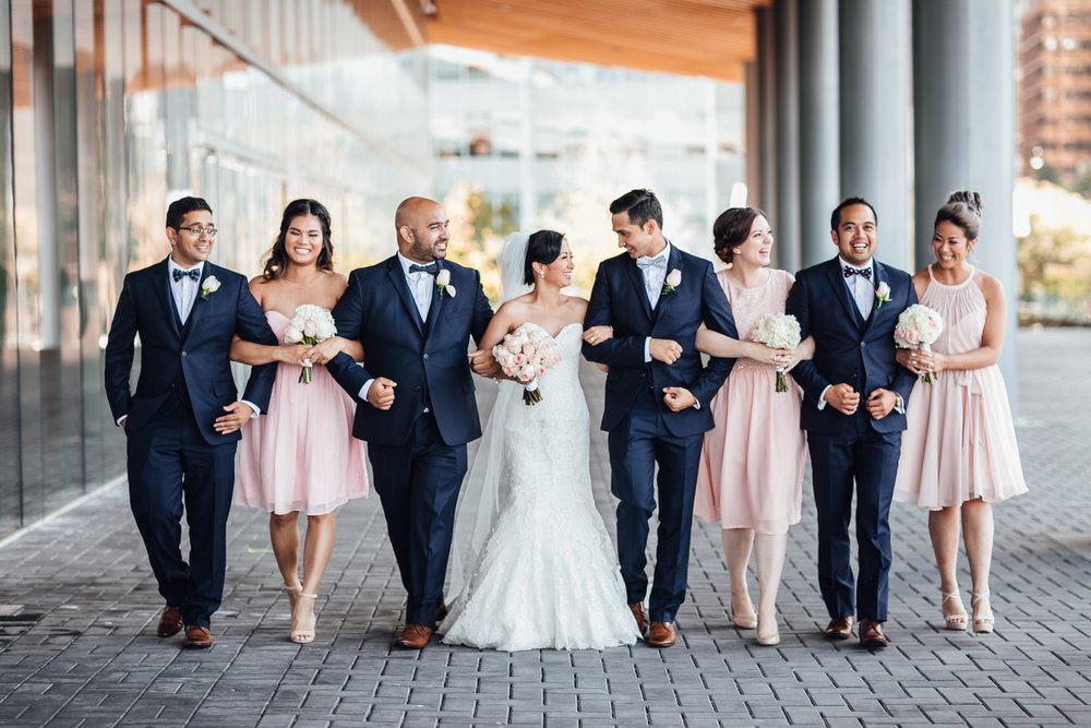 bridal party walking candid at vancouver convention centre wedding in coal harbour bc