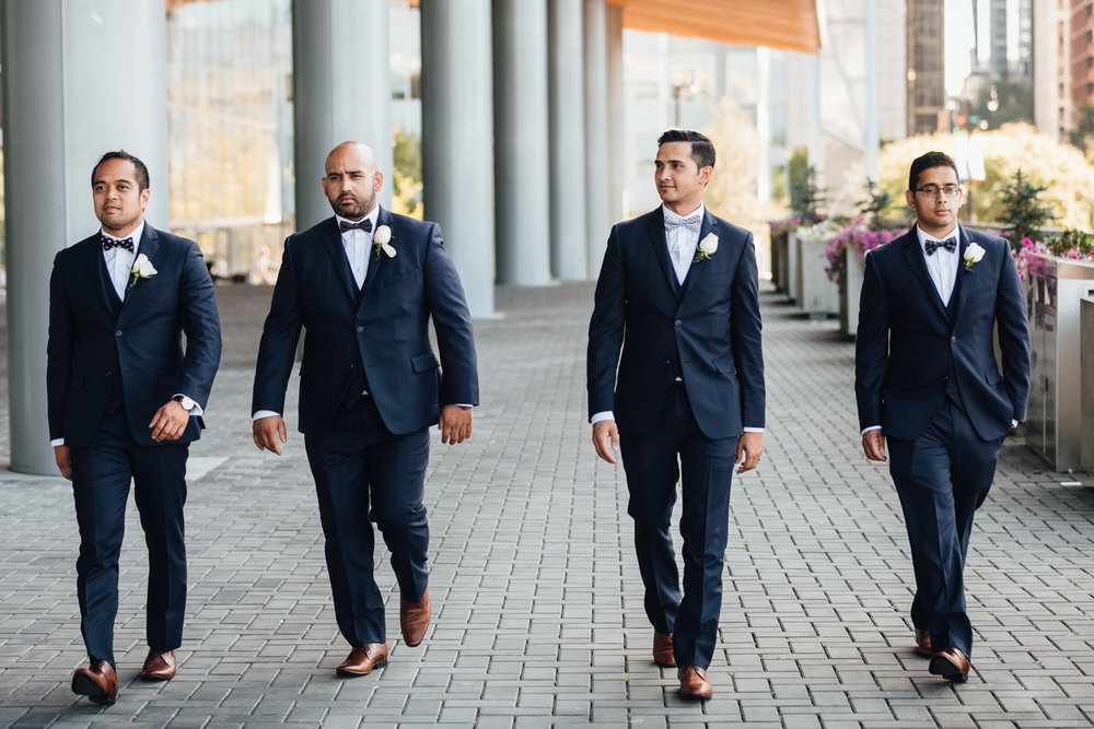 groomsmen and groom walking candid at the vancouver convention centre wedding