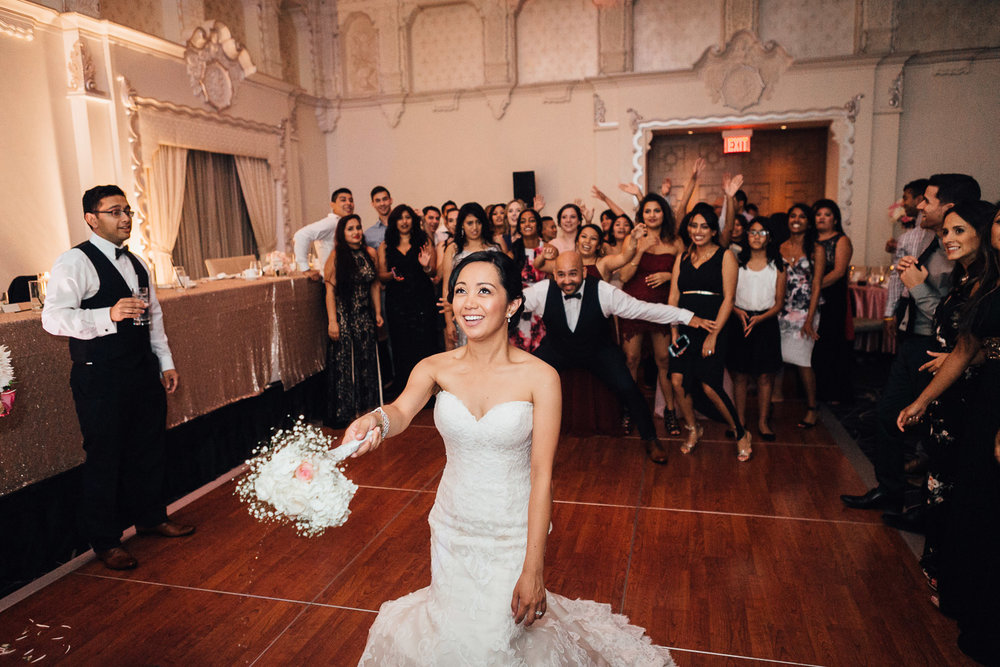 rosewood hotel georgia wedding reception photography bouquet toss   in vancouver bc