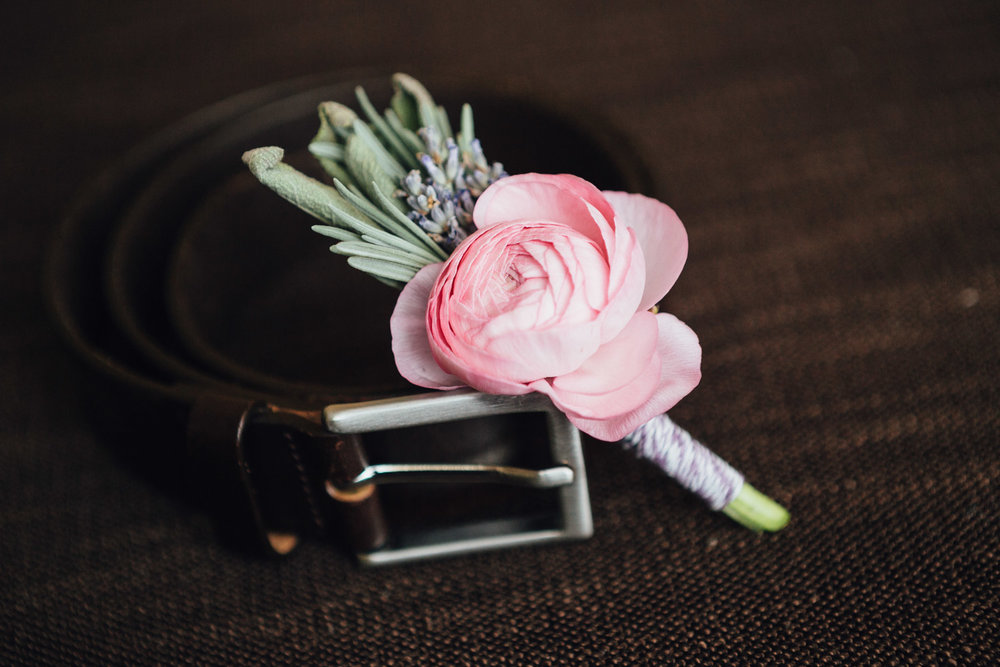 boutonniere and men's belt wedding day at river rock casino hotel photography