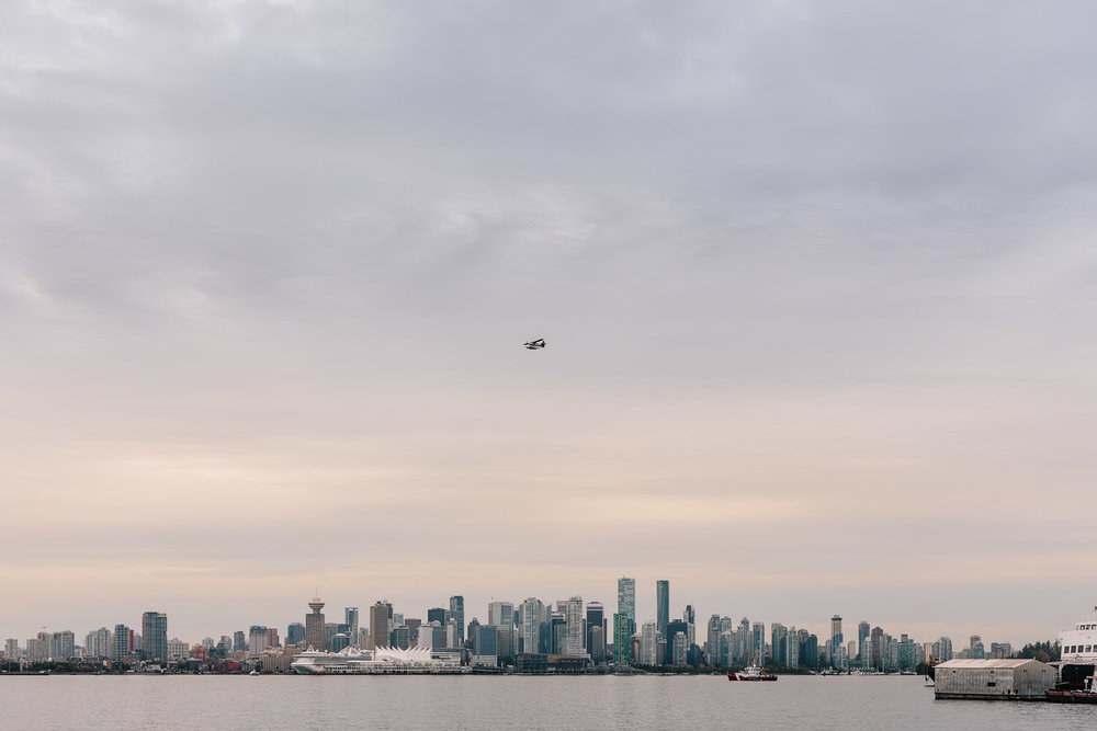 waterfront park view of vancouver engagement photography seaplane