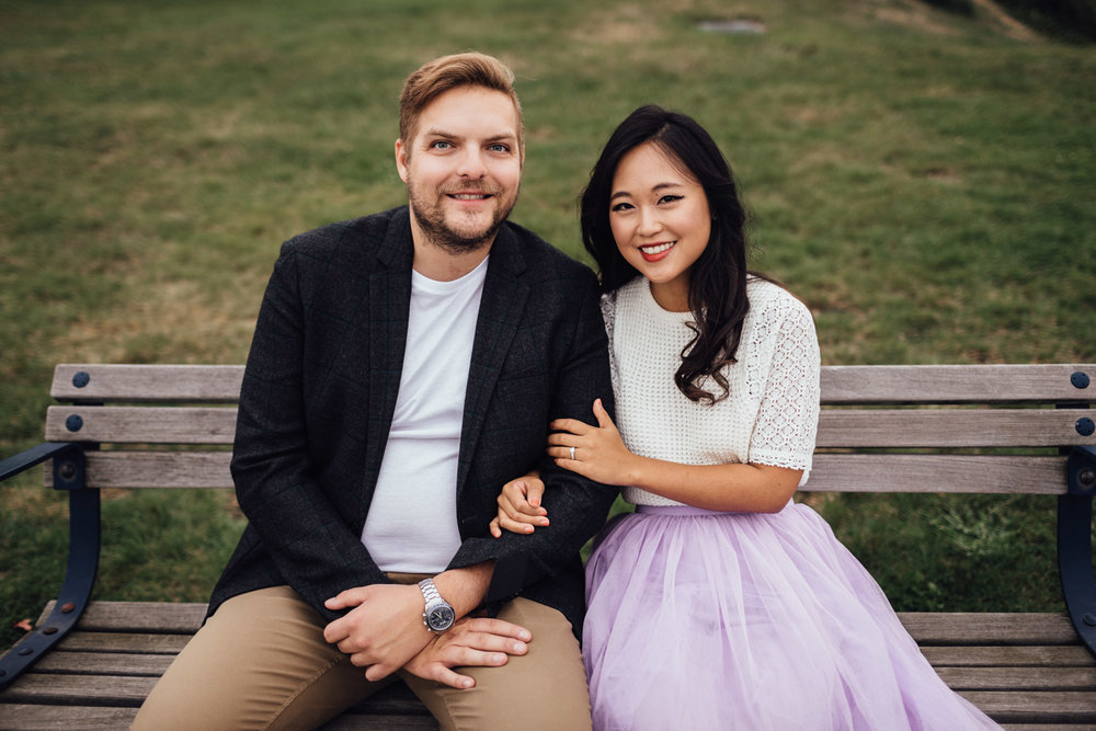 north vancouver couple sitting on bench laughing candid engagement photography pinterest