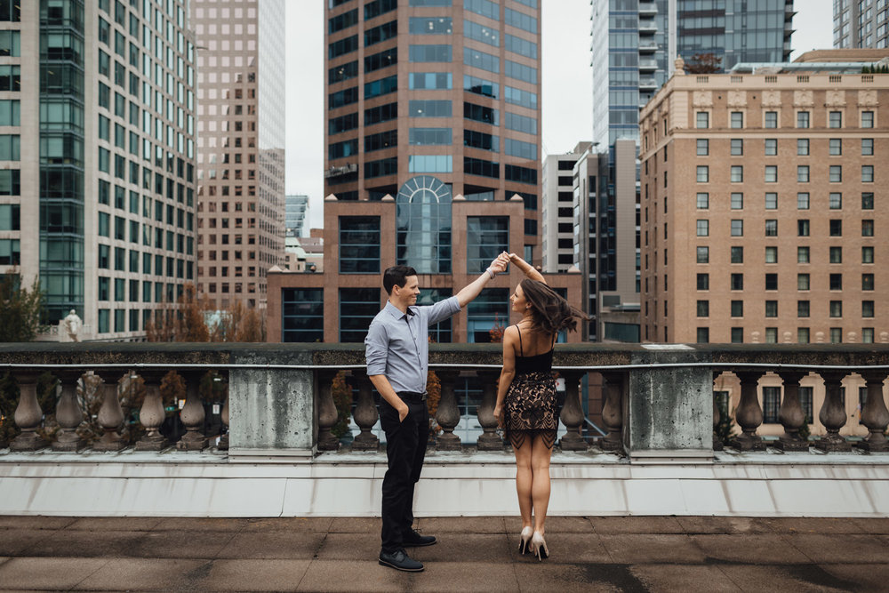 vancouver art gallery downtown engagement photography bc candid twirl rooftop