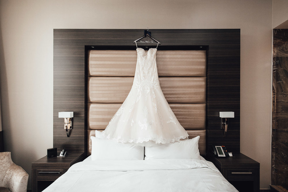 wedding dress in burnaby delta hotel photography