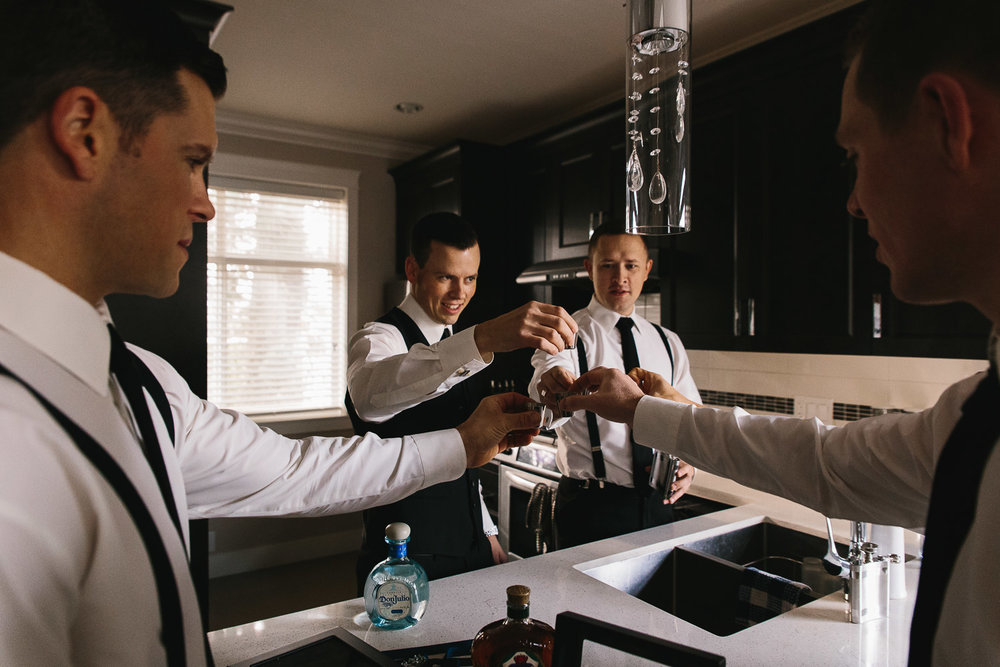 groom and groomsmen shots cheers getting ready wedding