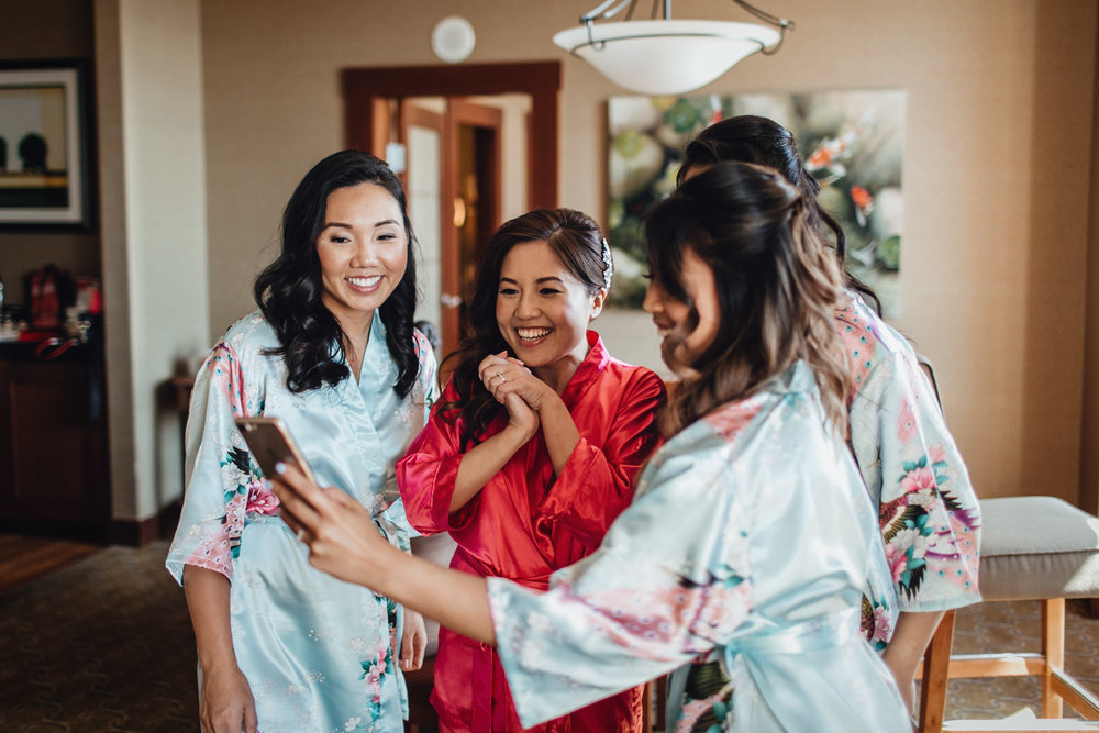 bride and bridesmaids candid robes river rock casino wedding photography