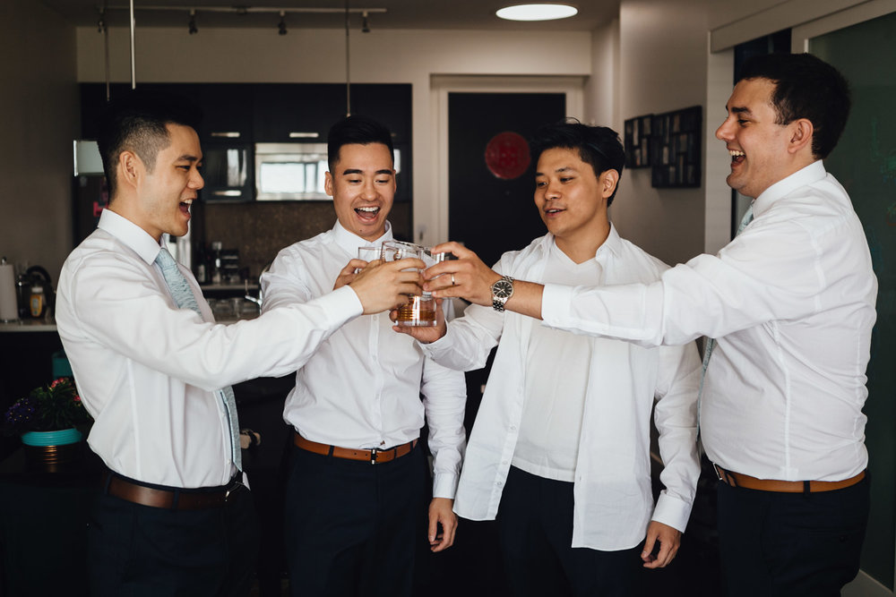 groom and groomsmen cheers alcohol vancouver getting ready wedding photography