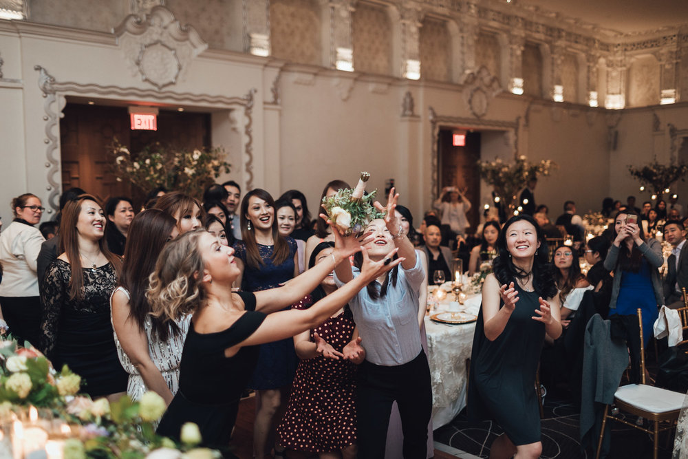 rosewood hotel georgia spanish ballroom wedding reception photography vancouver bouquet toss