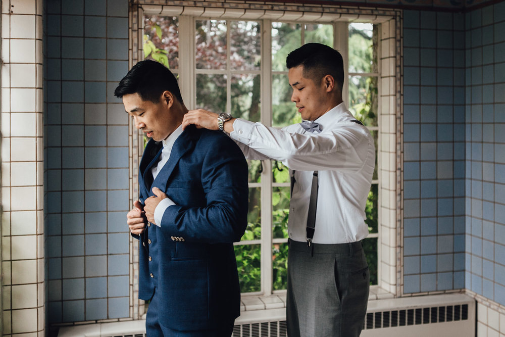 groom getting ready at university women's club of vancouver wedding photographer