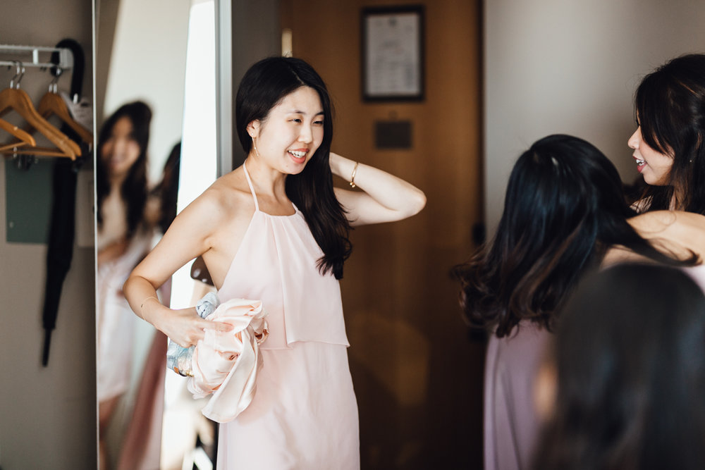 bride getting ready at auberge hotel in Coal Harbour, Vancouver BC wedding photography