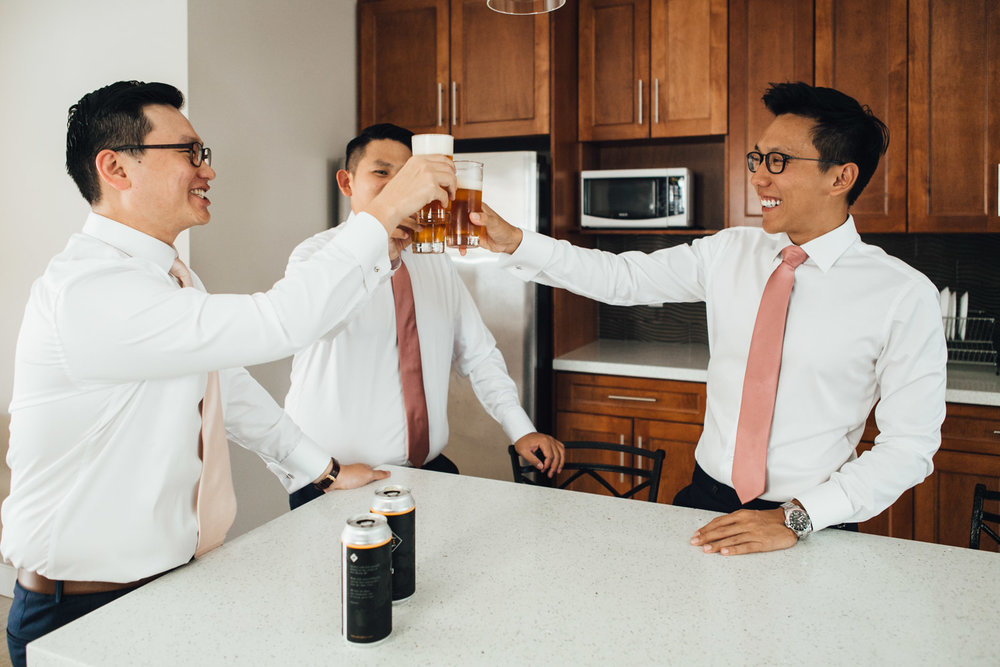 groom and groomsmen beer cheers singapore getting ready wedding photography