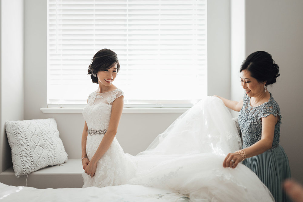 bride getting into wedding dress in burnaby